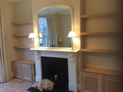 Alcove cupboard with floating shelves
